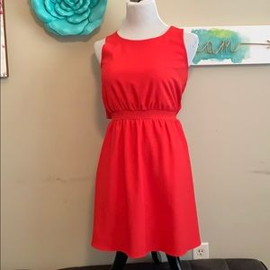 Adorable bright coral dress with back cut out